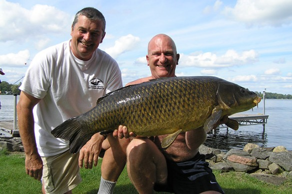 Mike and guest with great carp catch at Lakeside Cottages